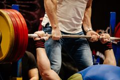 Powerlifter exercise bench press. Record weight barbell Stock Images