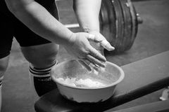 Powerlifter hands. Closeup of hands of the powerlifter in talc stock photography