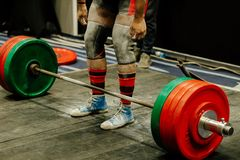 Powerlifter legs in gym chalk royalty free stock photography