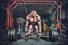 Powerlifter with strong arms lifting weights. In club Stock Images