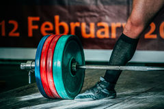 Powerlifter to compete in deadlift barbell. Heavy weight Royalty Free Stock Photography