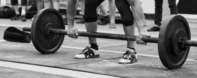 Powerlifting competitions in the street. Power race professional athletes. Implementation of grueling exercises. Photo for sports magazines, posters and Royalty Free Stock Photography