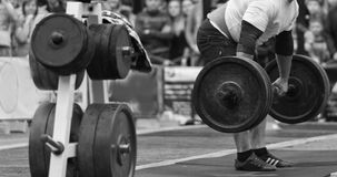 Powerlifting competitions in the street. Professional athletes perform strenuous exercise difficult. Photo for sports magazines, posters and websites Stock Photography
