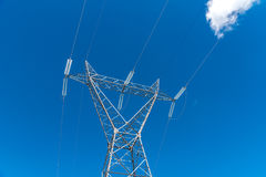 Powerline and the blue clear sky Stock Photography