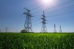 Powerline in direct sunlight. Bright day the landscape in backlighting royalty free stock image