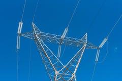 Powerline i błękitny jasny niebo Zdjęcie Stock
