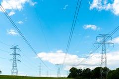 Powerline na polu Zdjęcie Royalty Free