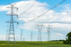 Powerline na polu Zdjęcie Stock