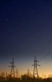 Powerline at night Stock Photo