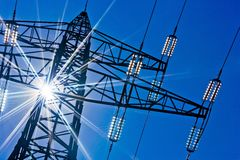 Powerline with sun Royalty Free Stock Images