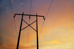 Powerline Sunset A. Beautiful soft sunset as backdrop for close-up of high voltage power line Royalty Free Stock Photography