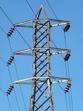 Powerline Tower and Blue Sky. This is an electrical power line tower under a blue sky Royalty Free Stock Photography
