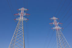 Powerline towers. Long lines of powerline towers Royalty Free Stock Image