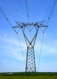 Powerline towers stretching across Royalty Free Stock Images
