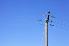 Powerline under blue sky Stock Photos