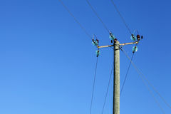 Powerline on wooden pillar Stock Photos
