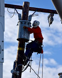Powerline Worker in Southern California. Works high on a power pole to bring electricity to homes Stock Image