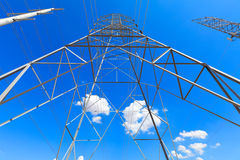 Powerlines. Against a blue sky with few clouds Royalty Free Stock Photos