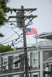 Powerlines with an American Flag. Powwerlines with an American flag, Edgartown Royalty Free Stock Images