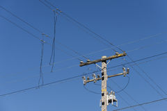 Powerlines. Electric lines and telephone pole. Deep blue sky. Strong diagonals Royalty Free Stock Images
