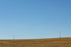 Powerlines on a Field Royalty Free Stock Photography