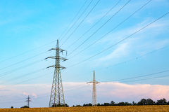 Powerlines on the field Stock Photo