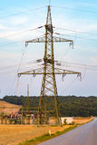 Powerlines on the field Royalty Free Stock Photos