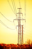Powerlines. Near houses in sunset Royalty Free Stock Photography