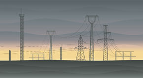 Powerlines at sunset. Landscape with electricity pylons and powerlines at sunset. All objects are layered and easy changeable Stock Photo