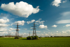 Powerlines under clowdy sky Royalty Free Stock Image