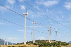 Powerlines and windmills Los Llanos windfarm Málaga Spain stock photo