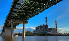Powerplant and bridge. Powerplant viewed from under the bridge Royalty Free Stock Photo
