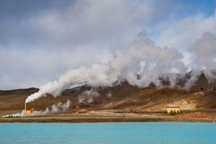 Powerplant. Turquoise lake, steam from chimney Royalty Free Stock Photos