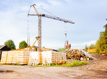 Powersaw bench - general view with many planks in the foreground Royalty Free Stock Photo