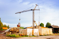 Powersaw bench - general view with many planks in the foreground Royalty Free Stock Image