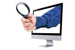 Powiększać - szklany biznesmen ręki monitor Odizolowywający Fotografia Stock