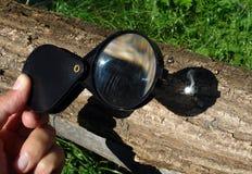 Powiększać - szklany zaczyna ogień obraz stock
