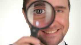 powiększający target401_0_ biznesmena szkło zdjęcie wideo