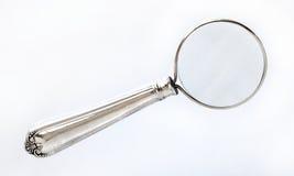 powiększenie szkła srebra fotografia stock