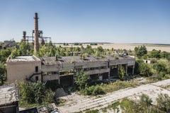 Powietrzny panoramiczny widok zaniechany przemysłowy teren, strefa, zaniechana fabryka lub magazyny, Zdjęcie Stock