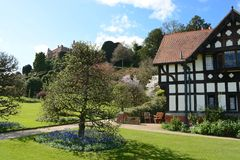 Powis castle garden. Powis castle and English garden with black and white building Royalty Free Stock Photos