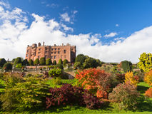 Powis Castle in Wales in Autumn. Scenic view of Powis Castle and stately home in its landscaped gardens in autumn sunlight. Powys, Wales, UK stock image