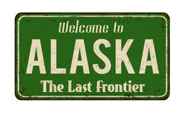 Powitanie Alaska rocznika metalu ośniedziały znak Zdjęcia Stock