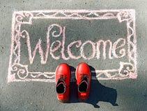 Powitanie, inskrypcja w kredzie Obrazy Stock