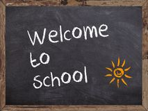 Powitanie szkoła pisać na blackboard Obrazy Royalty Free