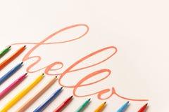 Powitanie zwrot ręcznie pisany z pomarańczowym markierem Obrazy Stock