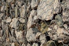 Powulkaniczna kamienia i stali sieć fechtuje się tekstury tło Obraz Stock