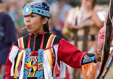 Powwow Dancers entrance ceremony. Ohsweken, Ontario, Canada, July 27, 2008. A young female Powwow Dancer in the casual entrance dance during the Grand River royalty free stock image