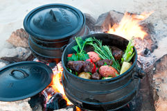 Poyke pot on the fire Royalty Free Stock Photography