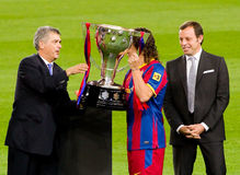 Puyol with Spanish League Trophy. BARCELONA - MAY 15: Carles Puyol of FC Barcelona receive the Spanish League Championship Cup in Camp Nou stadium, on May 15 stock image